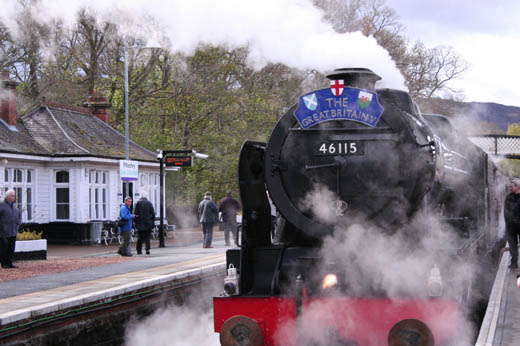 Steam train pulling in to Pitlochry train station
